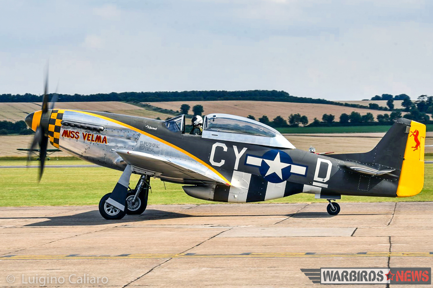 The ill-fated P-51D 'Miss Velma' taxies out for takeoff before the Balbo. As these words were written, the Mustang was already back at Duxford, on its gear, undergoing damage assessment. (photo by Luigino Caliaro)