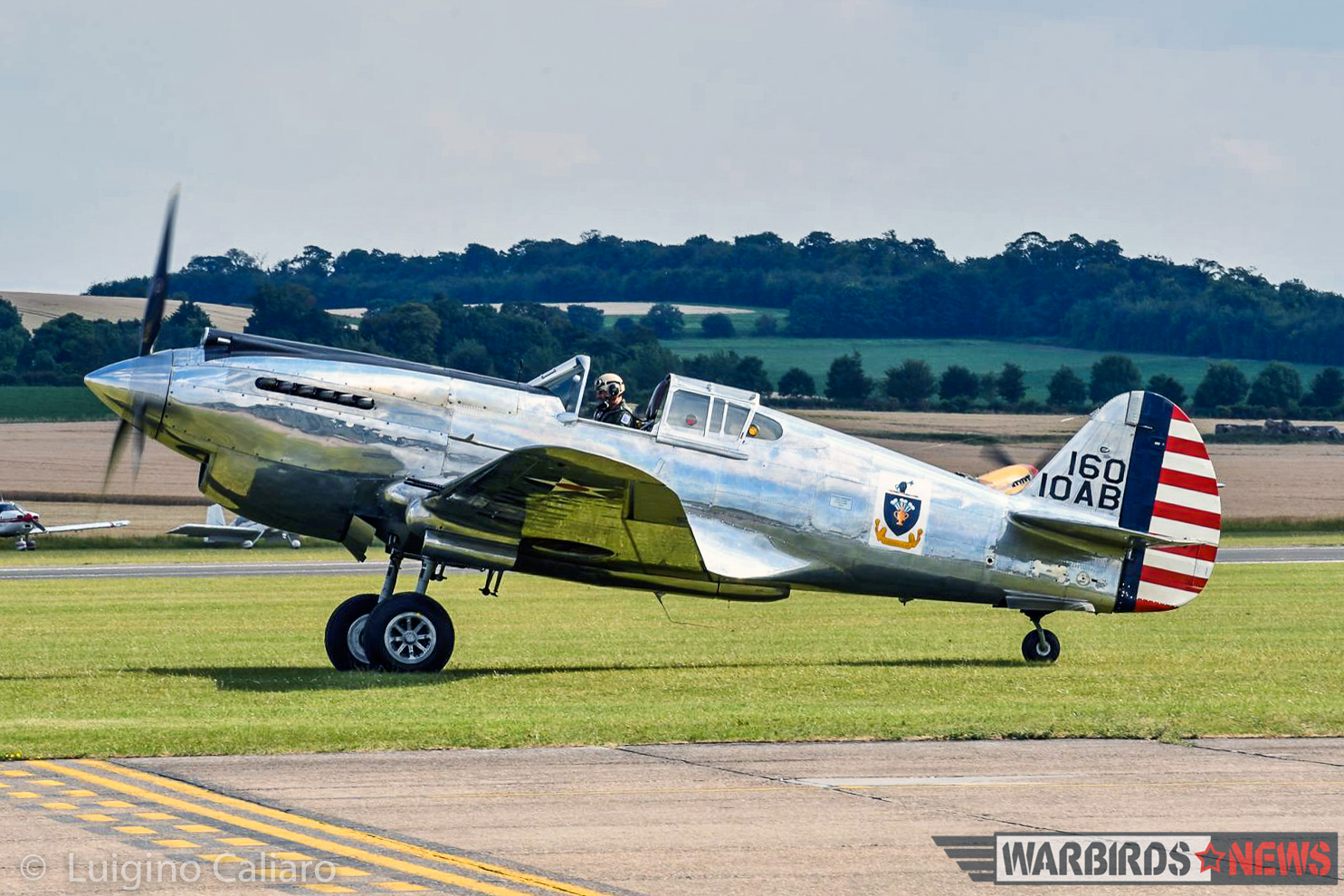 The Fighter Collection's dazzling P-40C 41-13357 taxies out for takeoff. (photo by Luigino Caliaro)