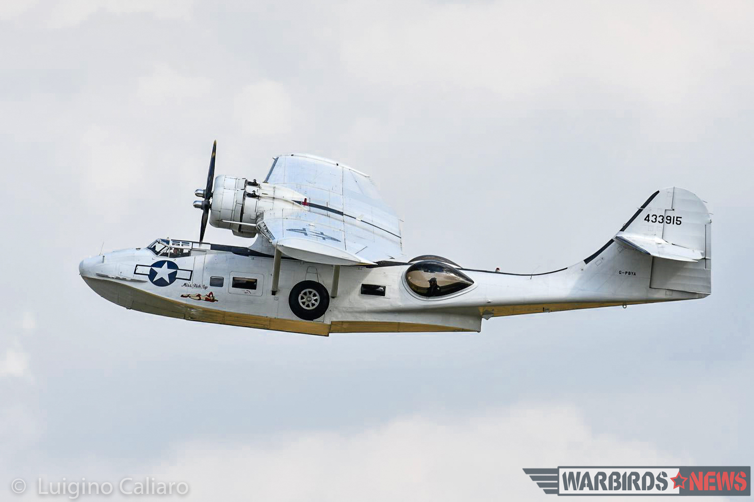 Plain Sailing's Canso A, a Canadian-built version of the Consolidated PBY-5A Catalina, rumbles across the Duxford sky. (photo by Luigino Caliaro)