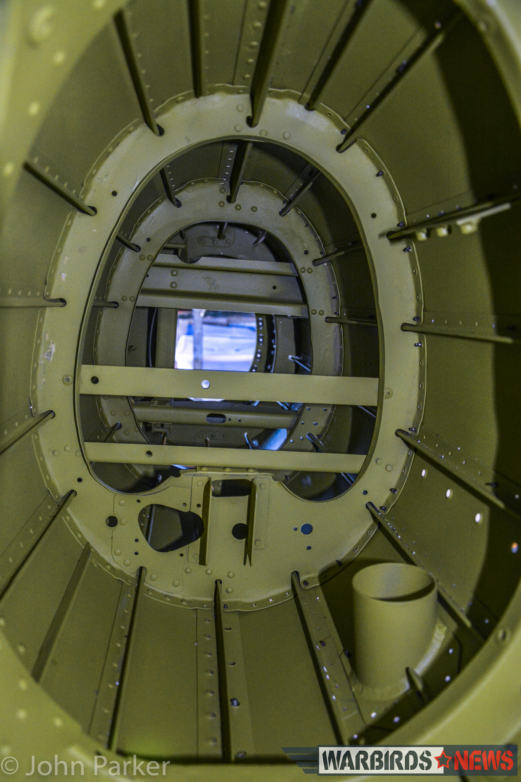 Looking down the inside, restored section of a tail boom towards the unrestored area. (photo by John Parker)