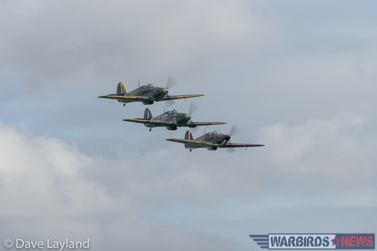 Three Hurricanes tuvk in close for a formation flypast. (photo by Dave Layland)
