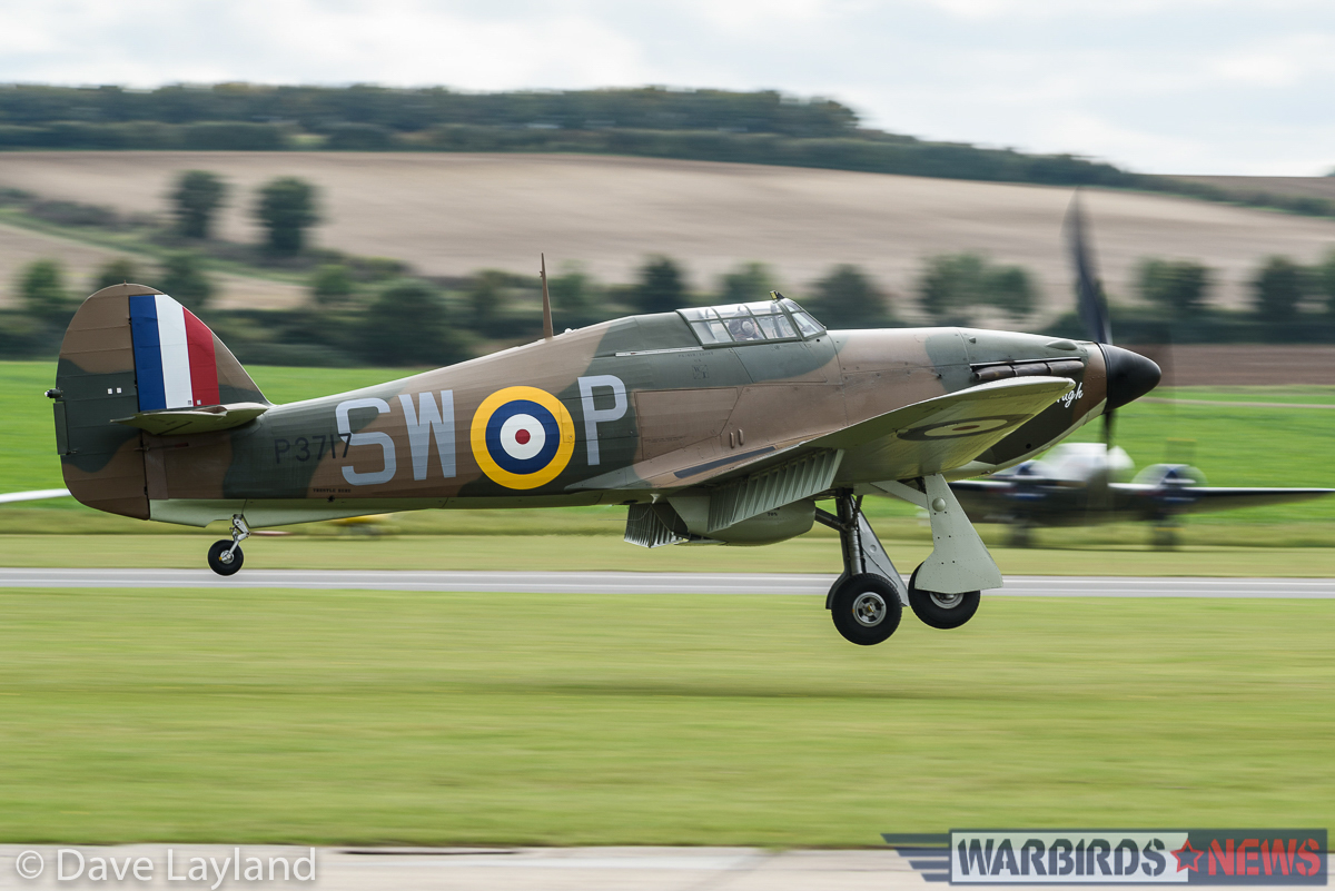 Hurricane Mk.I P3717 of Hurricane Heritage just before she touches down on Duxford's grass runway. (photo by Dave Layland)