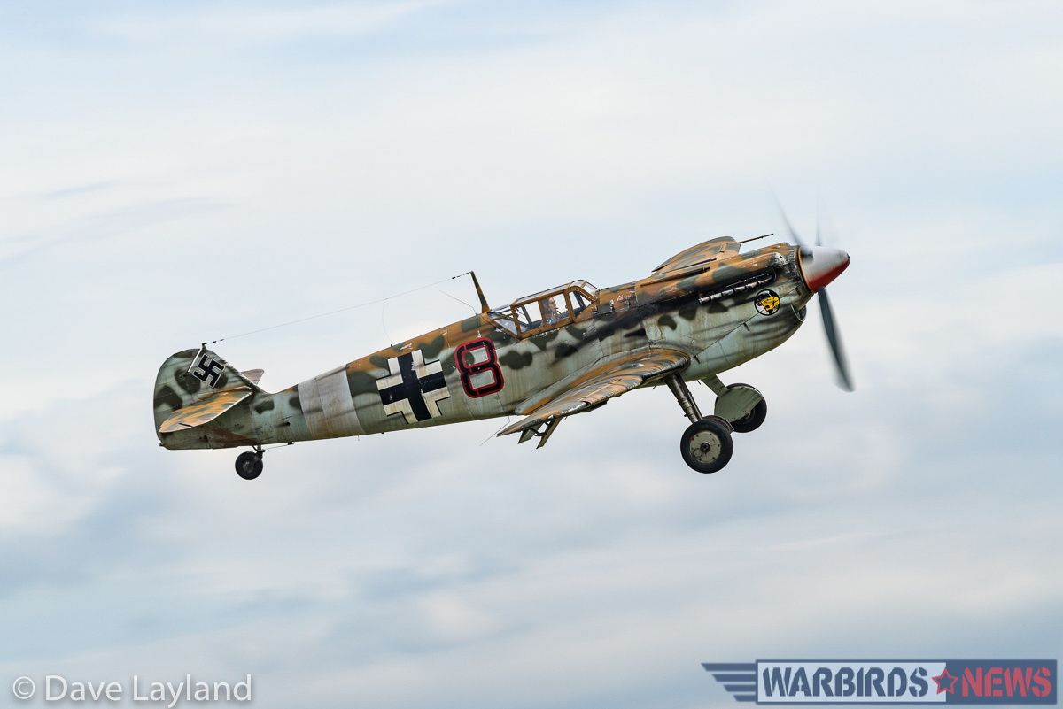 The Aircraft Restoration Company's Hispano Buchon dummied-up to look like a war-weary, desert- camouflaged Bf-109 of JG.27. (photo by Dave Layland)
