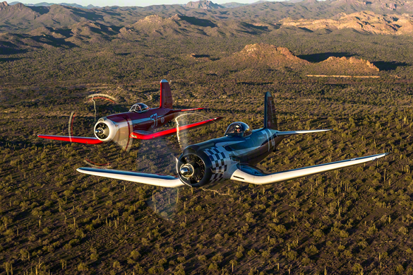 Taken during Moose's most memorable photo shoot, Super Corsairs, Race #57, an F2G-1D, and Race #74, an F2G-2 fly over the Arizona desert.