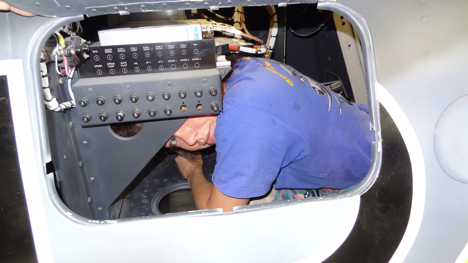 Lindsey Goss inside the tight confines of the FW-190 fuselage installing some of the aircraft's wiring harnesses. (photo via GossHawk Unlimited)