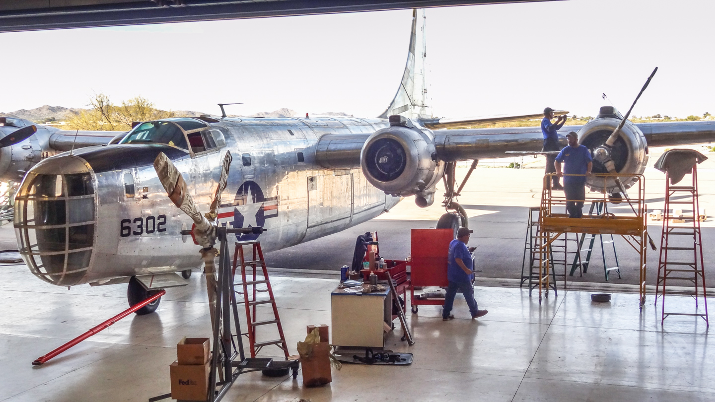 Installing the last of the newly-overhauled propellers in January, 2015. (GossHawk Unlimited photo)