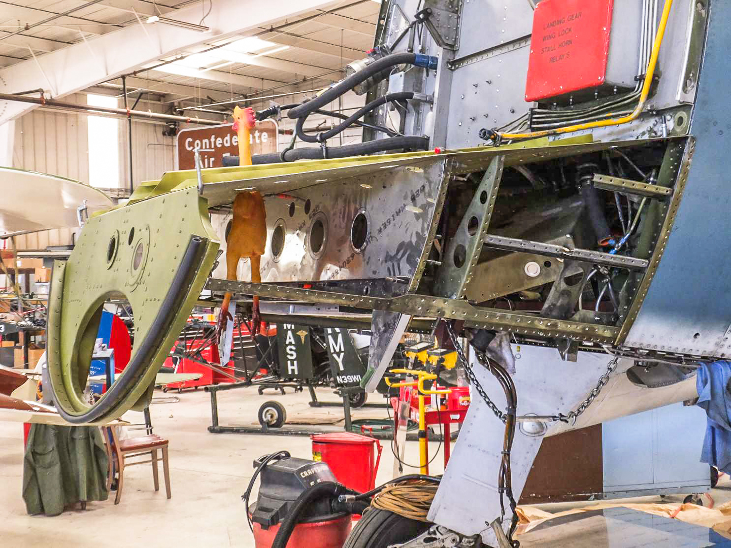 The forward fuselage and engine bay also required a lot of work, which is ongoing. Here you can see the repairs to the lower forward fuselage and firewall. (photo via CAF)
