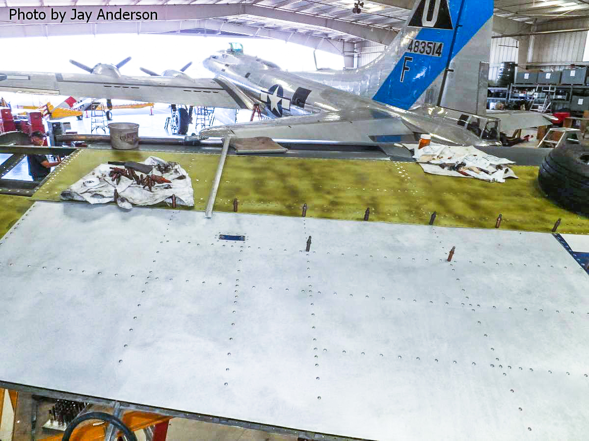 "New skins going on the left outer wing panel following internal wing repairs. Note the CAF's B-17G ""Sentimental Journey"" in the back ground. (photo by Jay Anderson)"