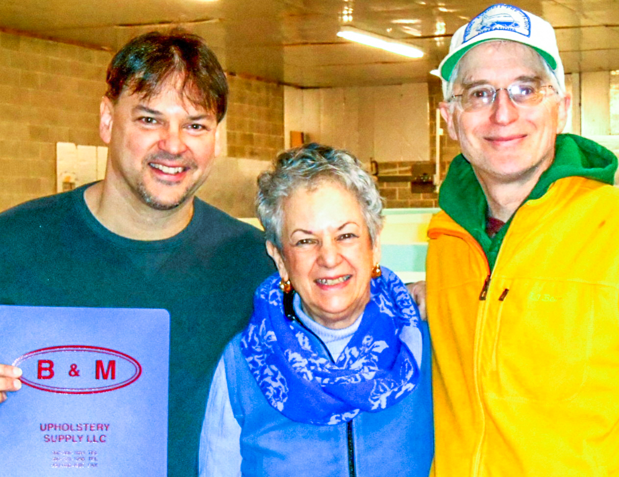 Bob Gagnon, Jr. and Mary Gagnon from B & M Upholstery Supply with Willie Althammer, DC-3 restoration volunteer. (photo via NEAM)