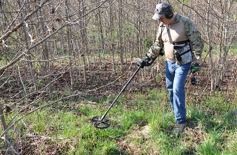 Greg Covington - the historian from Gentile's home town of Piqua, Ohio who did the bulk of the research - at work on the crash site with his metal detector. (photo by David Cohen)