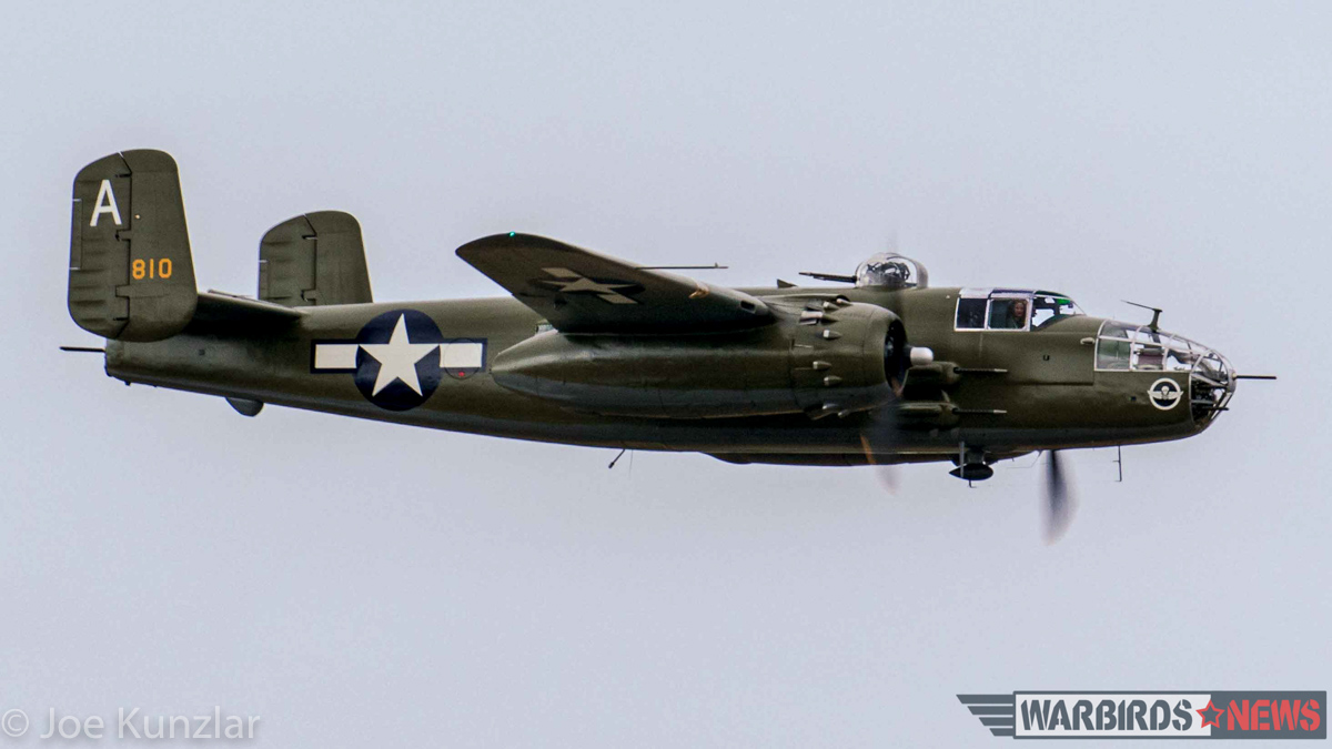 The Flying Heritage Collection's North American B-25J Mitchell roars past the crowd at Paine Field during one of the museum's fly-days. (photo by Joe Kunzlar)