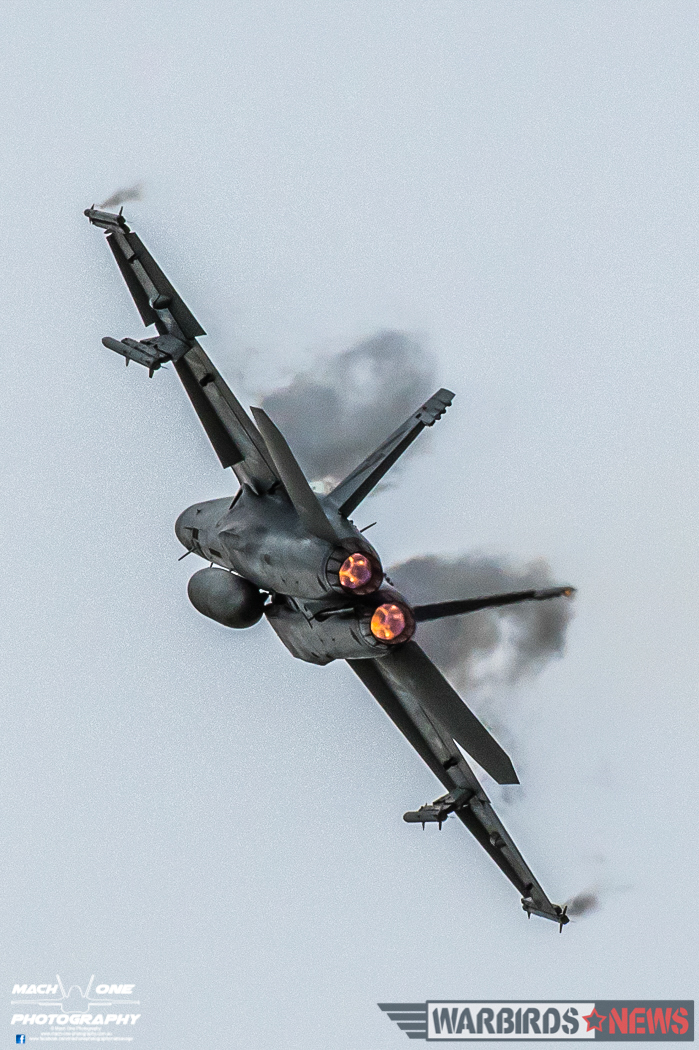 Boeing F/A-18F Rhino A44-201 of 1 Squadron making clouds of its own during its handling display. (Photo by Matt Savage/Mach One Photography)