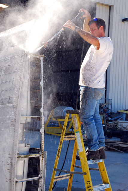 Cleaning the wings after a decade of storage in Chino is messy work - Feb.2009 - Dan Newcomb photo