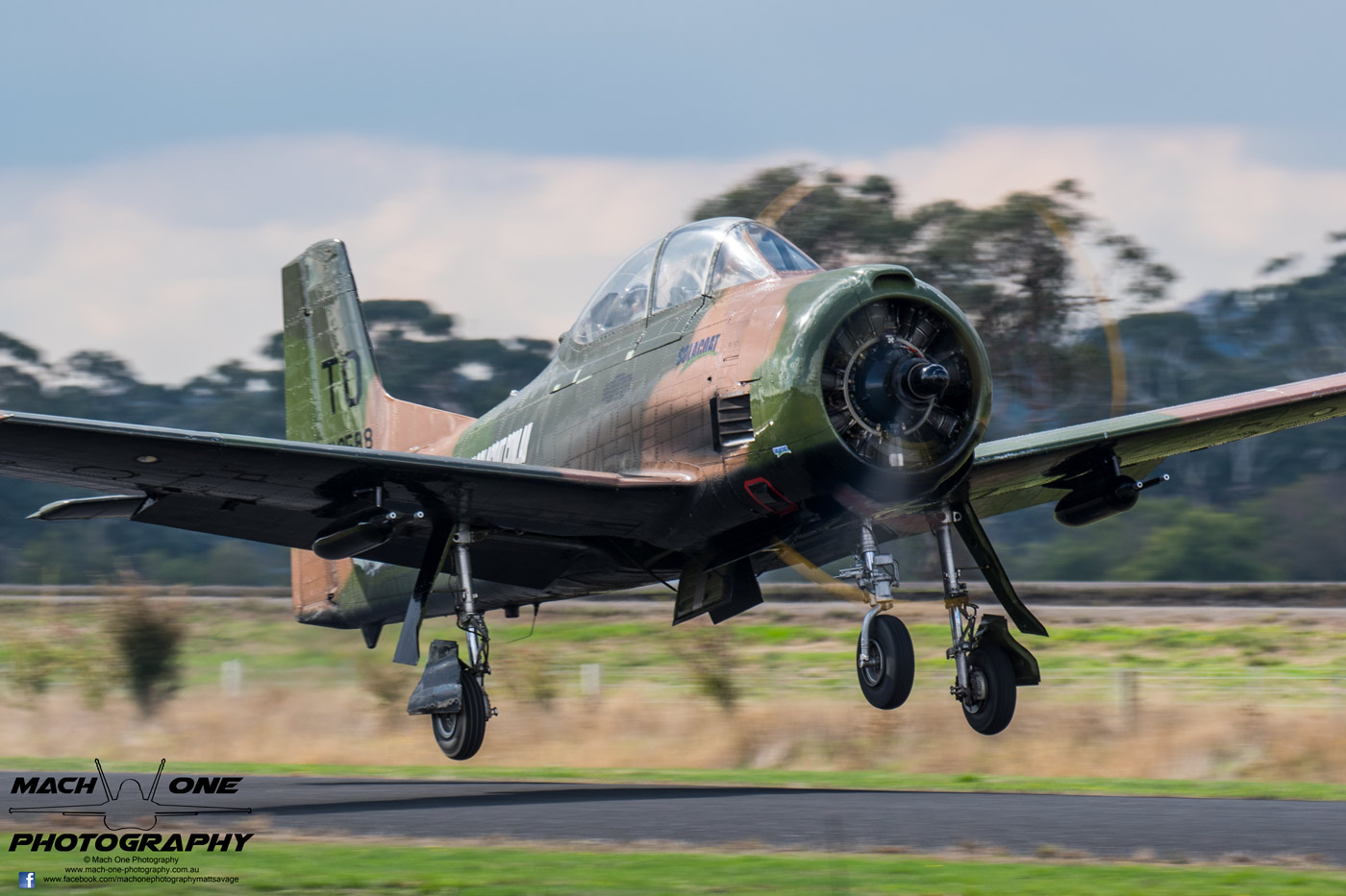 Chris Godfrey launches with a throaty roar in his combat-veteran T-28D Trojan.