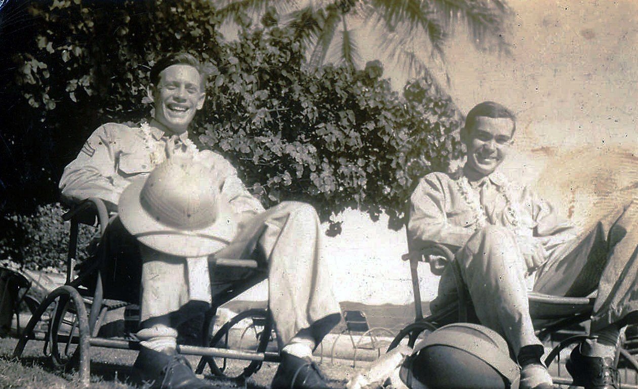 The author's dad, Herb Gilmore, with his buddy, Bill Hoagland, with pith helmets and wearing leis in Honolulu.