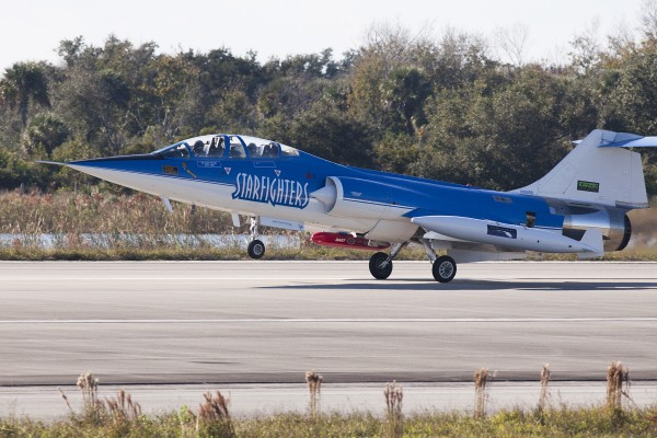 An F-104 Starfighter jet lands at Kennedy Space Center in Cape Canaveral on Tuesday after completing the maiden flight of a device known as Dust at Altitude Recovery Technology, or DART, which is being used to sample African dust in Florida's atmosphere for potential pathogens of humans, plants and animals. The DART is the red, cylindrical device shown attached to the jet. UF/IFAS photo by Tyler L. Jones.