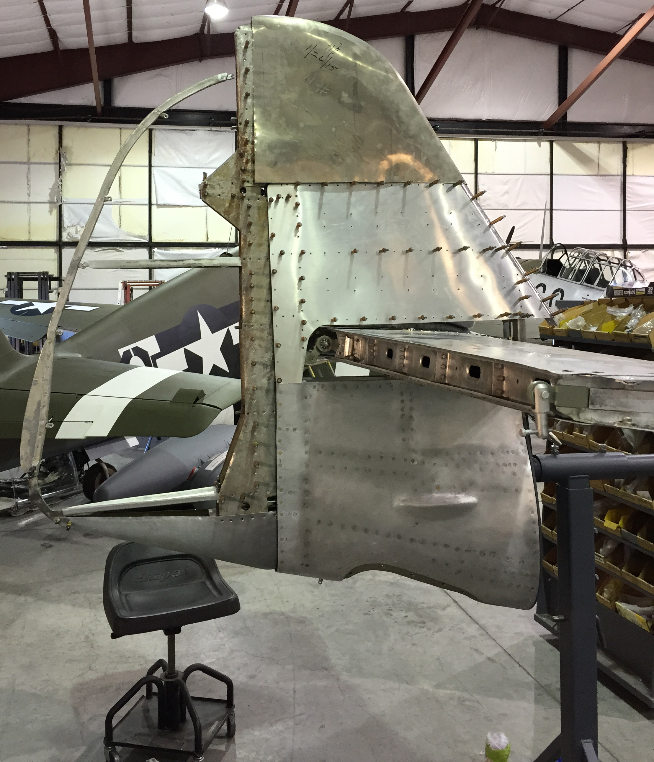 The rudder and vertical stabilizer coming together at Pacific Fighters. The rudder leading edge and counterweights shown here are from a French crash site and being used as patterns, alongside original German blueprints, to recreate the proper G-10 tail assemblies. (photo via Pacific Fighters)