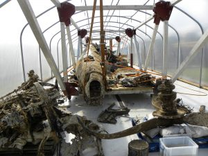 The larger pieces of the the Dornier Do 17 still receiving their citric acid soak in the specially-constructed hydration tunnels. (Image Credit: RAF Museum)