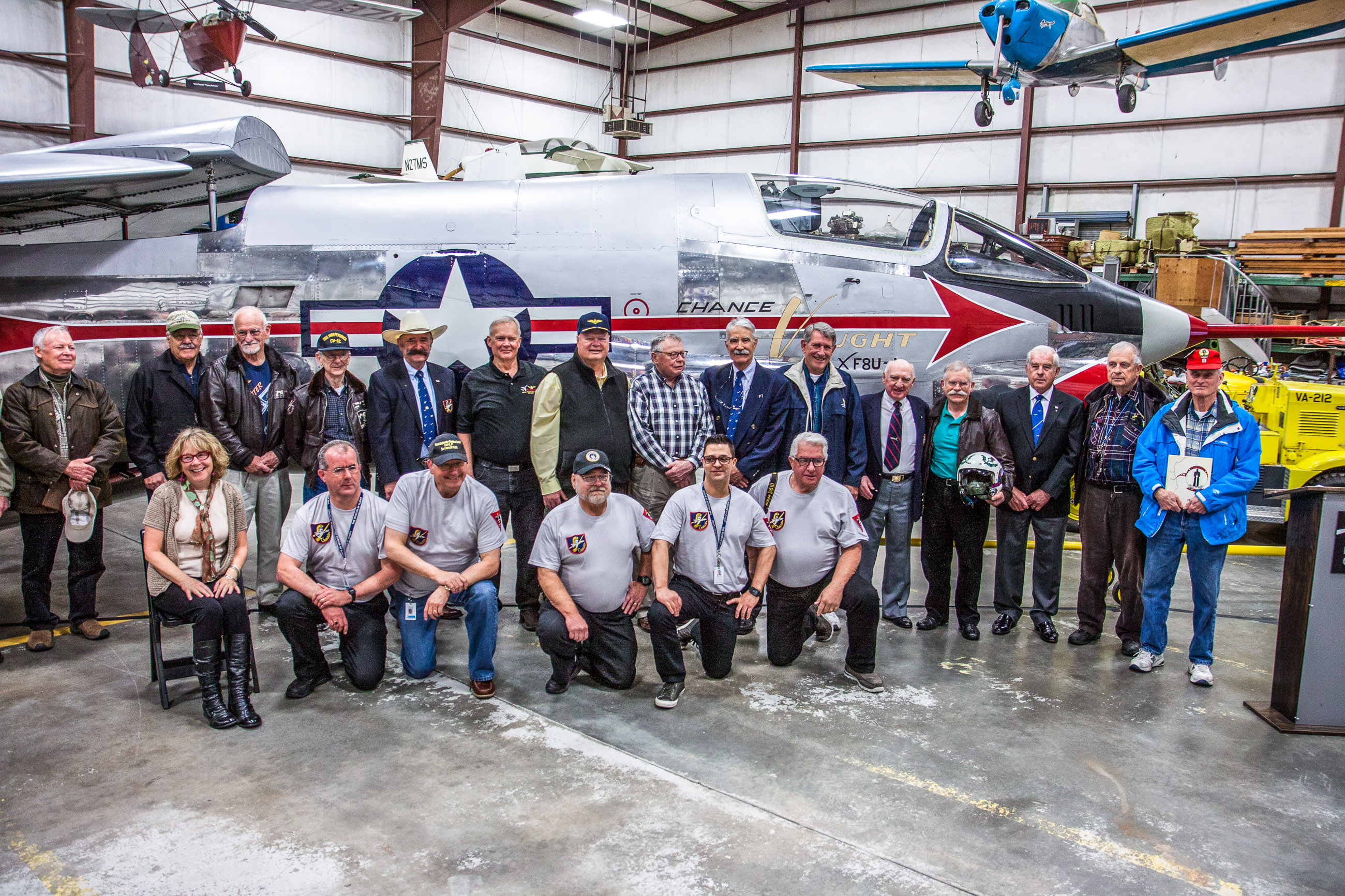 The Museum of Flight's restoration team (kneeling in t-shirts) and the honored guests - the former Crusader pilots standing behind. (photo by Ted Huetter/Museum of Flight)