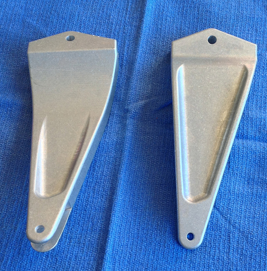 The newly fabricated aileron attachment forks. (photo via Tom Reilly)