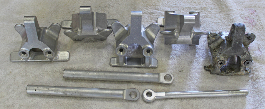 The newly manufactured up-lock forgings and rods. The original, corroded example can be seen on the extreme right. (photo via Tom Reilly)