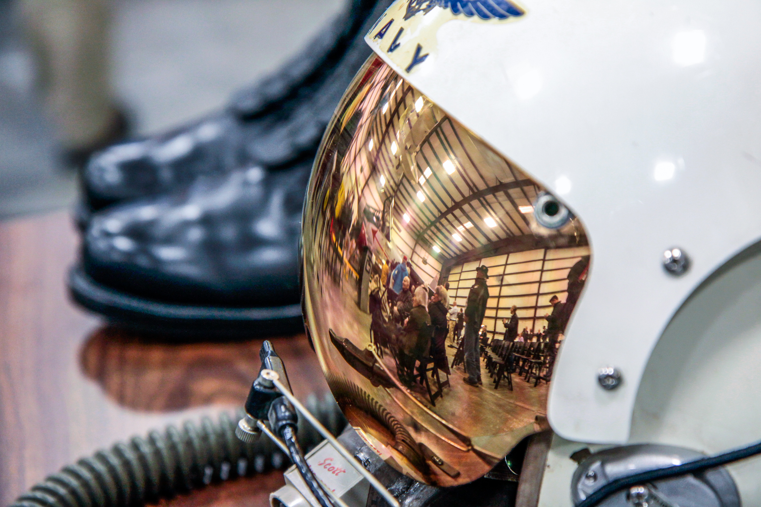 The XF8U-1 Crusader unveiling ceremony artistically caught in the visor reflection from a period US Navy flight helmet at the Museum of Flight's restoration hangar in Everett, Washington. (photo by Ted Huetter/Museum of Flight)