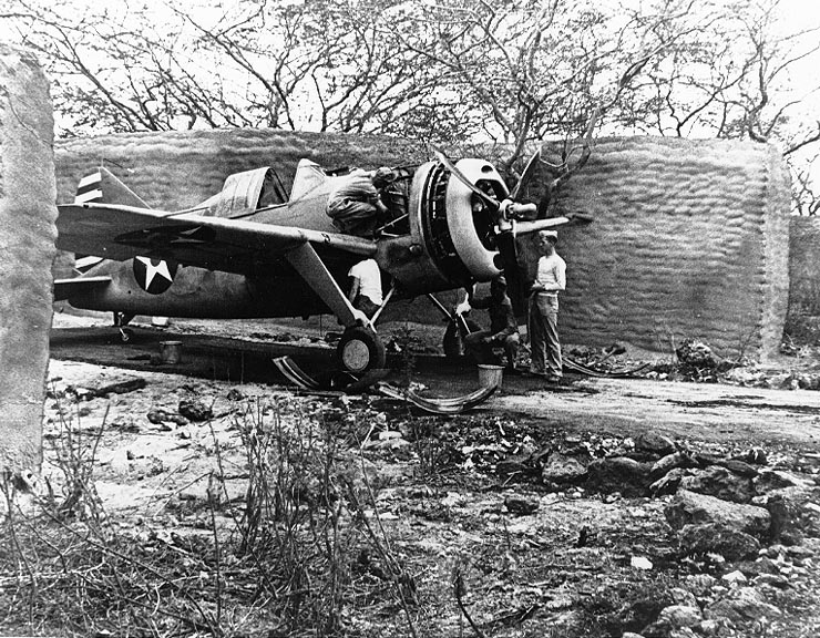 A Brewster F2A Buffalo (probably from Marine Corps Fighter Squadron VMF-221) undergoing maintenance in one of the early sandbag and stucco revetments at MCAS Ewa in April 1942.