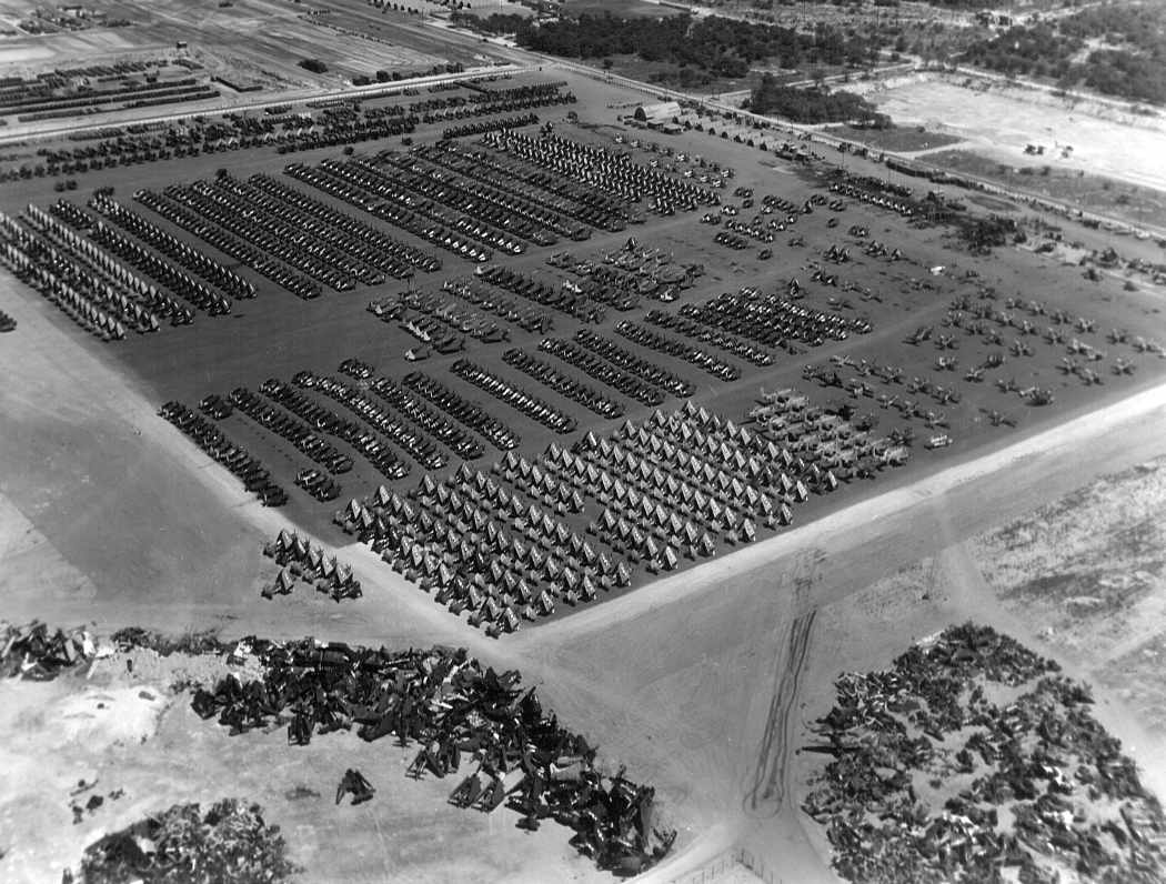 Oct. 1945: A month after Japan's unconditional surrender, the ramps at Ewa being used to inventory and deactivate hundreds of USN and USMC aircraft. Awaiting their fate are Corsairs, Wildcats, Hellcats, Avengers, Helldivers, and various other combat aircraft. The cluster of aircraft in the foreground are Avenger torpedo-bombers, already beginning the scrapping process.