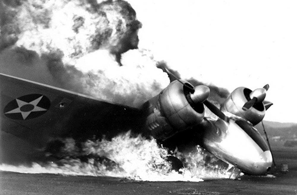A Lockheed JO-2 Electra Junior burning at Ewa during the Pearl Harbor attack.