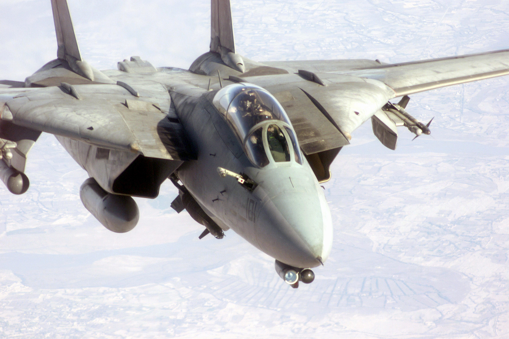 An F-14D prepares to refuel with probe extended A U.S. Navy F-14D Tomcat flies up with its refueling probe out preparing to connect with a tanker. The F-14 is armed with two AIM 9 Sidewinder missiles, a Paveway II Laser Guided GBU-10 2,000-pound bomb, and LANTIRN Pod, as it prepares for a bombing mission over Afghanistan in support of Operation ENDURING FREEDOM.Camera Operator: SSGT MICHAEL D. GADDIS, USAF - ID:DF-SD-03-06180 / Service Depicted: Navy / 011107-F-5795G-006 / Operation / Series: ENDURING FREEDOM. ( Image via Wikipedia)