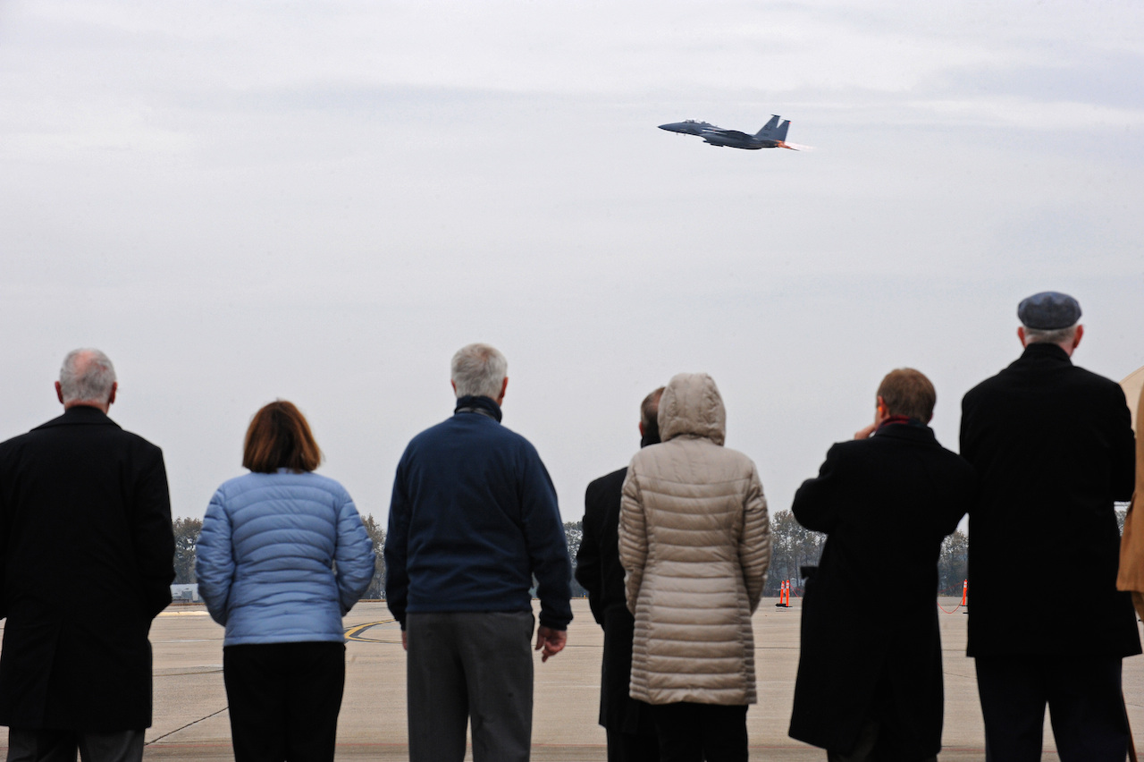 Family and friends of Capt. William Jarman Jr., an F-4 Phantom pilot with the 335th Tactical Fighter Squadron during the 1960s, who died in 1969 during an aircraft collision over Fort Bragg, N.C., watch as an F-15E Strike Eagle takes off from Seymour Johnson Air Force Base, N.C., Nov. 14, 2014. Jarman's family and friends visited the base to connect with the Airmen of the 335th Fighter Squadron, a squadron Jarman dedicated his life to. (U.S. Air Force photo/Airman 1st Class Aaron Jenne)