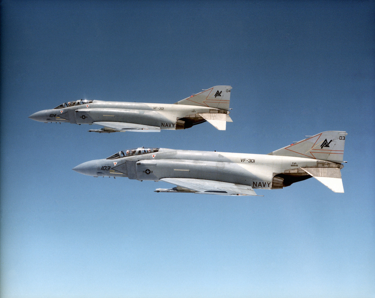 Port view of two F-4S Phantom II, Fighter Squadron (VF)-301, Devil's Disciples, NAS Miramar, in flight. (Photo by PPH2 BRUCE TROMBECKY - USNavy)
