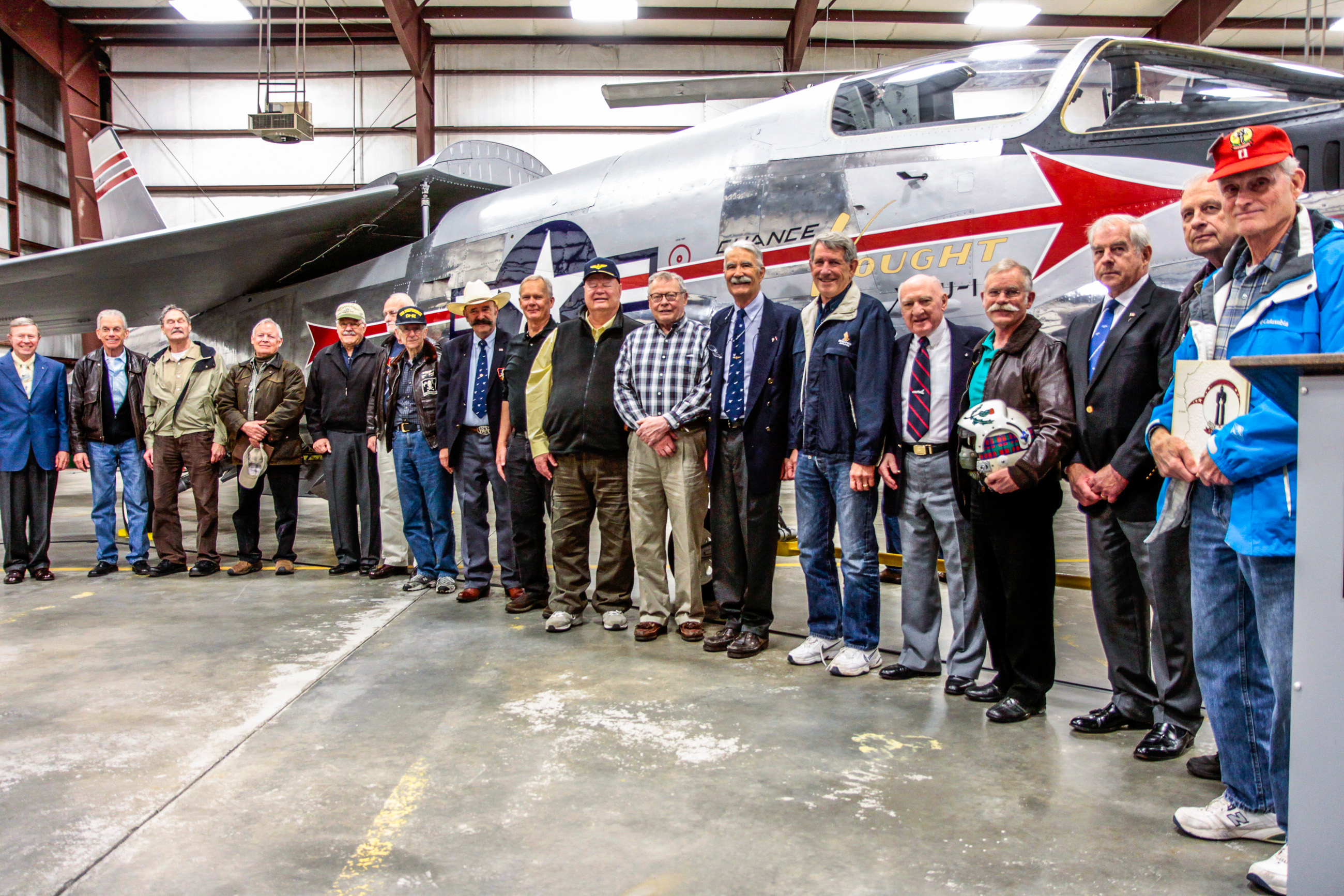 Former Crusader pilots stand in front of the XF8U-1 following the unveiling ceremony at Museum of Flight's restoration hangar in Everett, Washington. (photo by Ted Huetter/Museum of Flight)