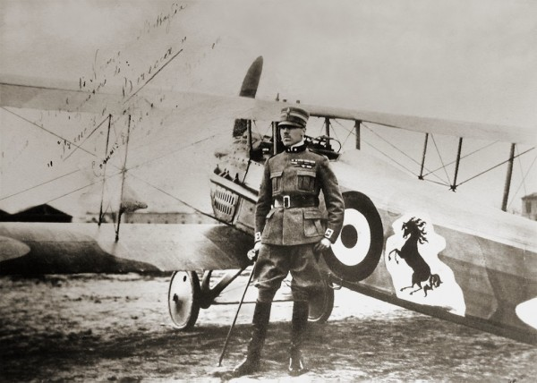 Count Francesco Baracca, standing by his SPAD XIII fighter with the prancing horse logo that later became the emblem of Ferrari.
