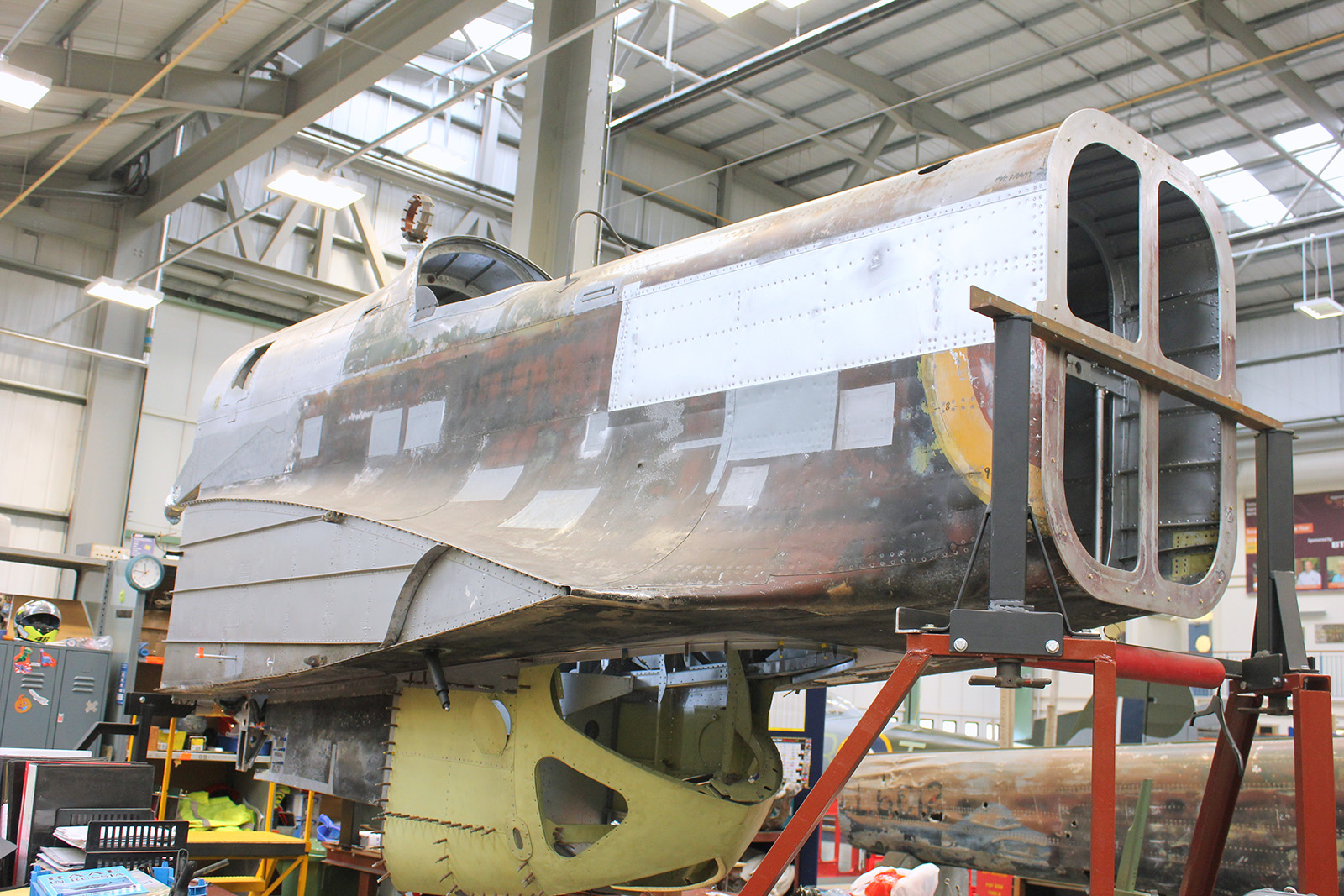 P1344's rear fuselage section in its jig and almost structurally complete. Notice the tail boom in the background. You can clearly read the serial number L6012 on its side. (photo by Geoff Jones)