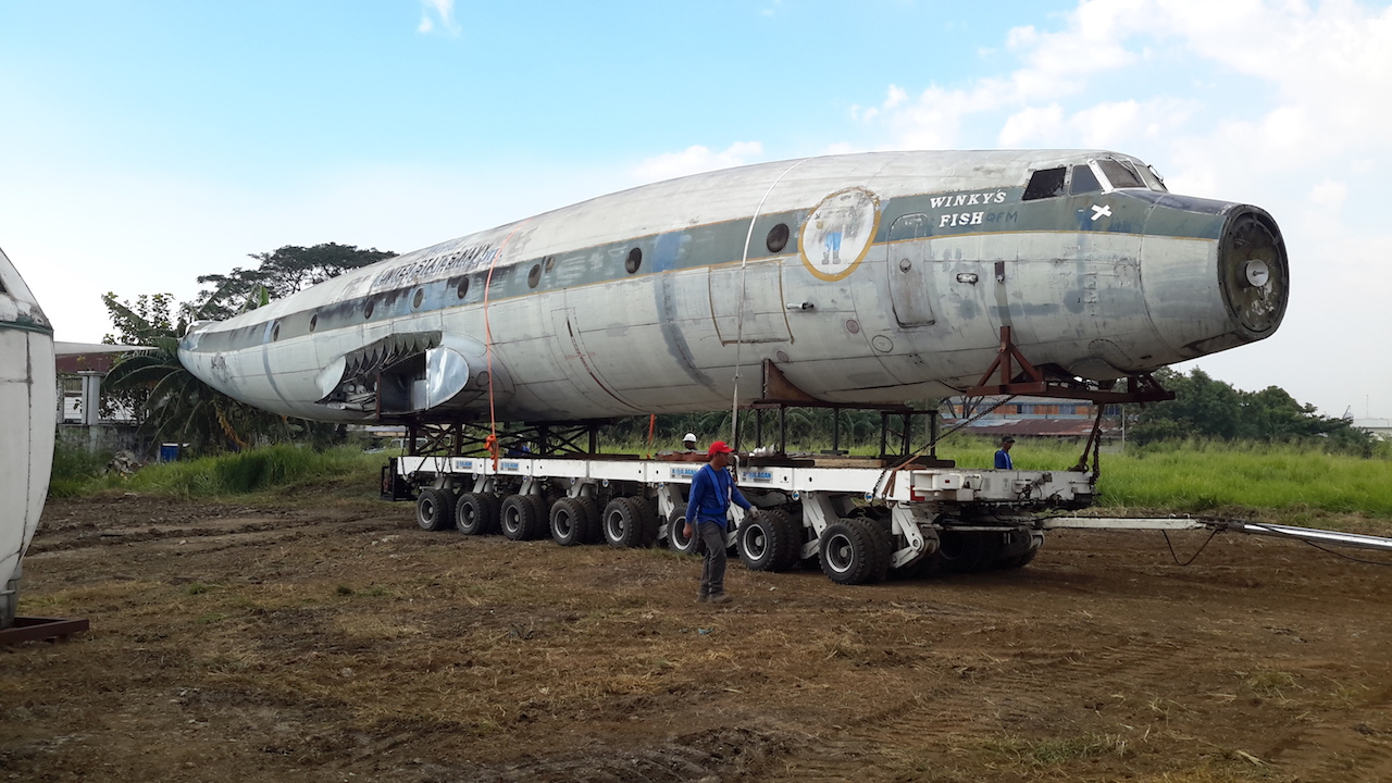 "The fuselage of the ""Connie"" moved to the storage facility."