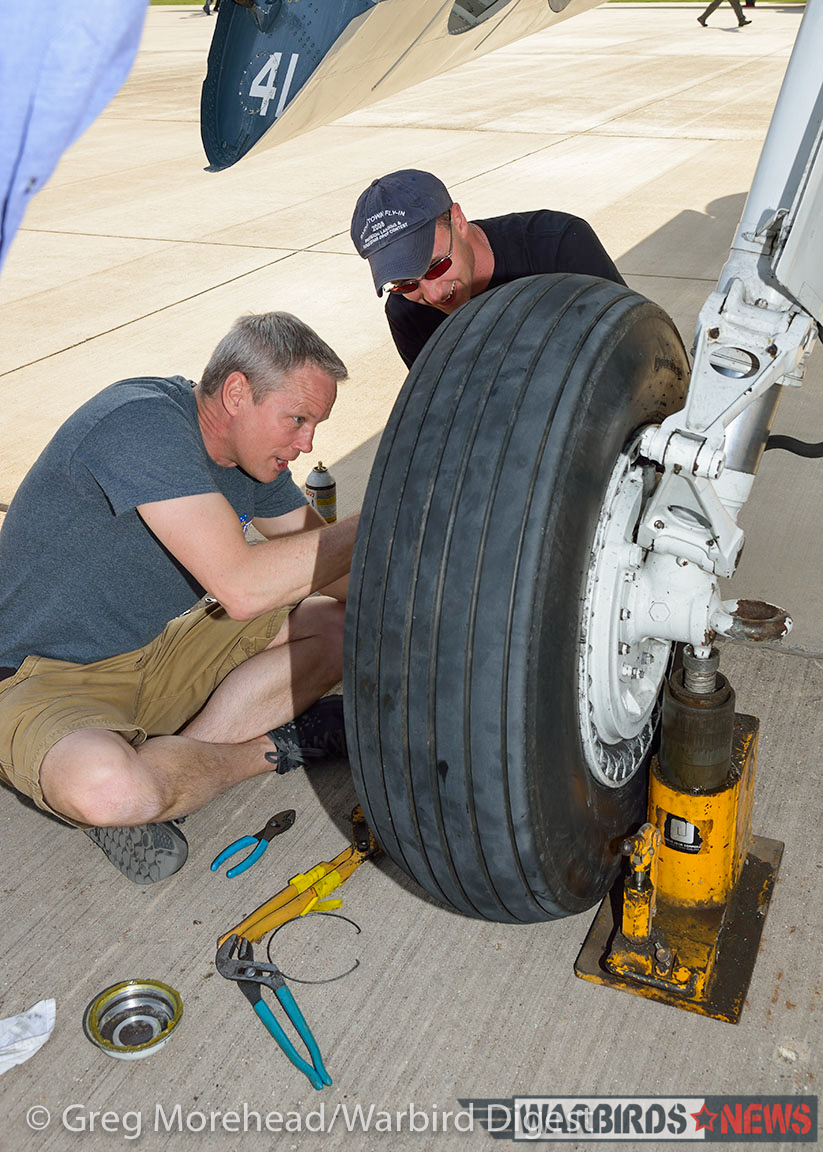 Working on the undercarriage. The scale of the tire to the man gives some idea of how massive the TBM is! (photo by Greg Morehead, courtesy of Warbird Digest magazine)