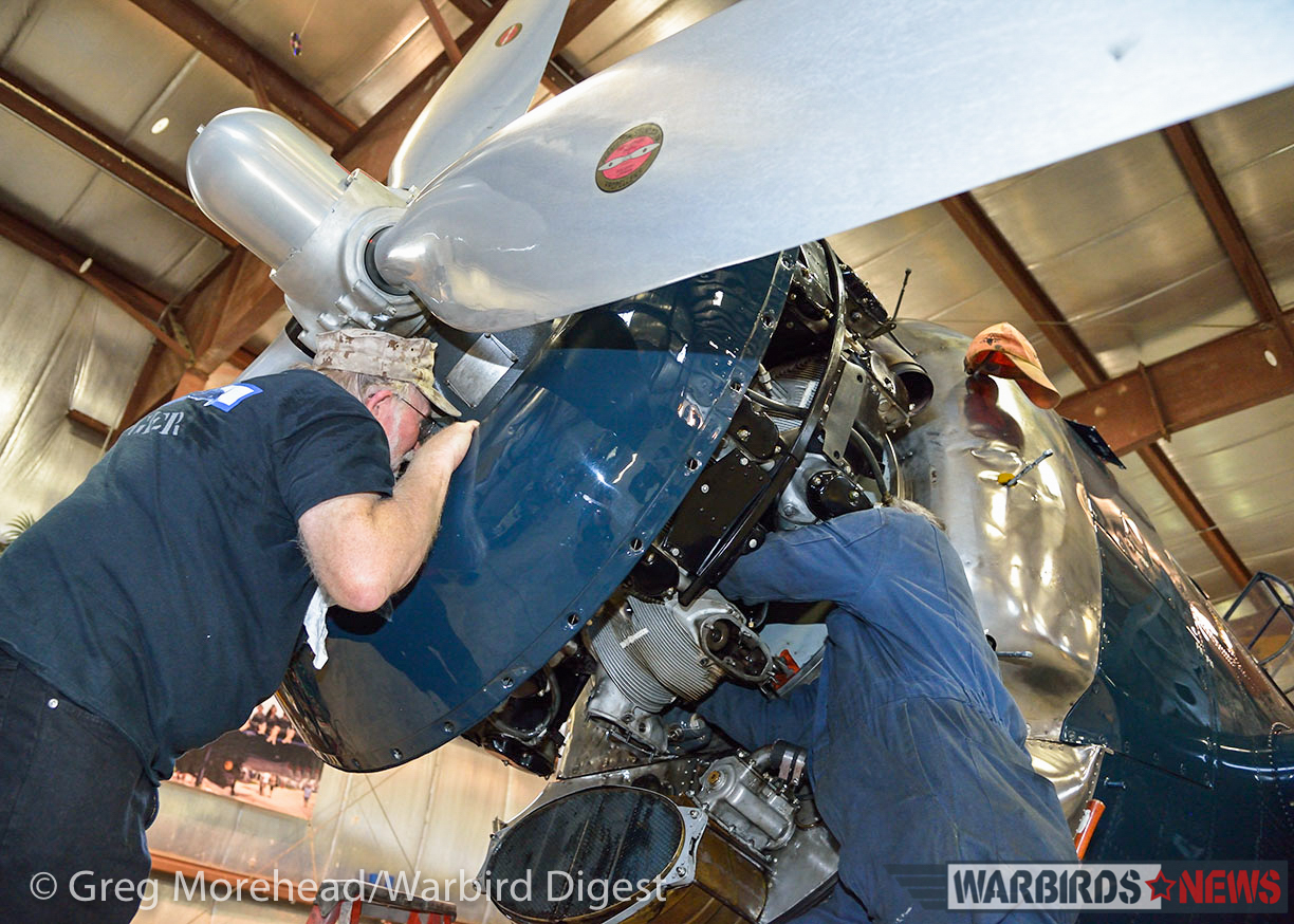 Working on the engine of the recalcitrant Avenger. (photo by Greg Morehead, courtesy of Warbird Digest magazine)