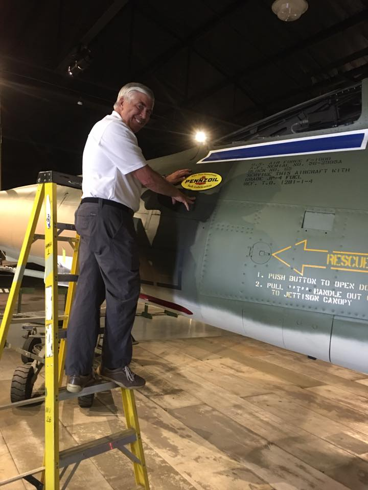 Gen Goddard applying the famous Penzoil sticker.