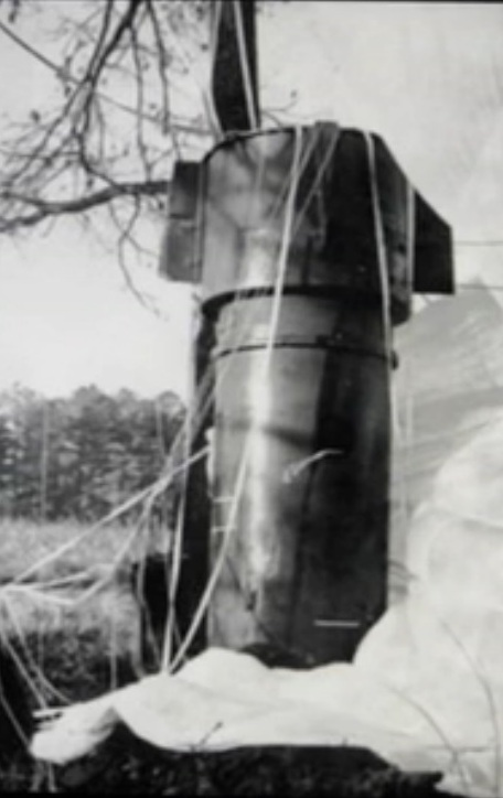 Close up of one of two Mk.39 thermonuclear bombs rests in a field in Faro, NC after falling from a disintegrating B-52 bomber. (image via Wikipedia)