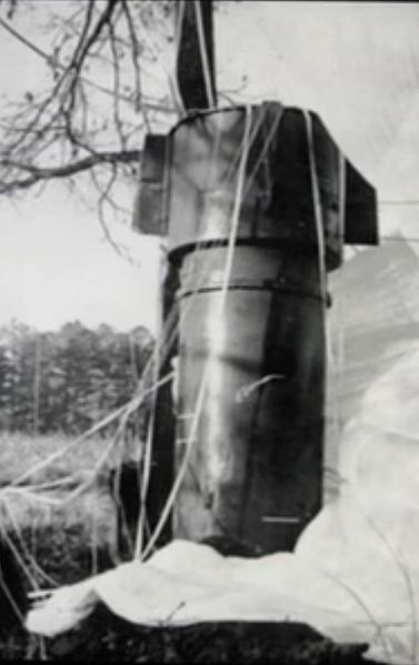 """Close up of one of two Mk.39 thermonuclear bombs rests in a field in Faro, NC after falling from a disintegrating B-52 bomber in an incident known as the """"1961 Goldsboro B-52 crash."""""""