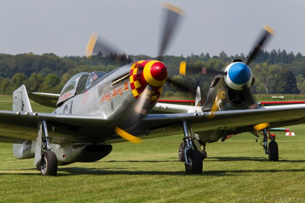 P-51 Mustang and P-40 Warhawk made the trip from France to attend. (Image Credit: Andreas Zeitler)