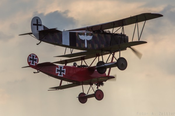 Fokker Albatros D.VII and Fokker Dr.I triplane demonstrate the capabilities of WW I aircraft. (Image Credit: Andreas Zeitler)