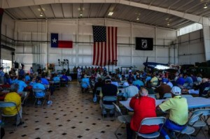 Aviation legends gathered inside the hangar.