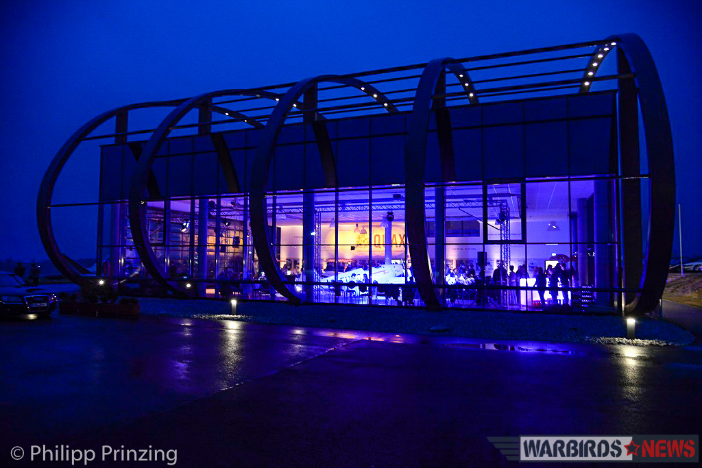 A view of Quax's fantastic hangar at night, showing their new prize illuminated within. (photo by Philipp Prinzing)