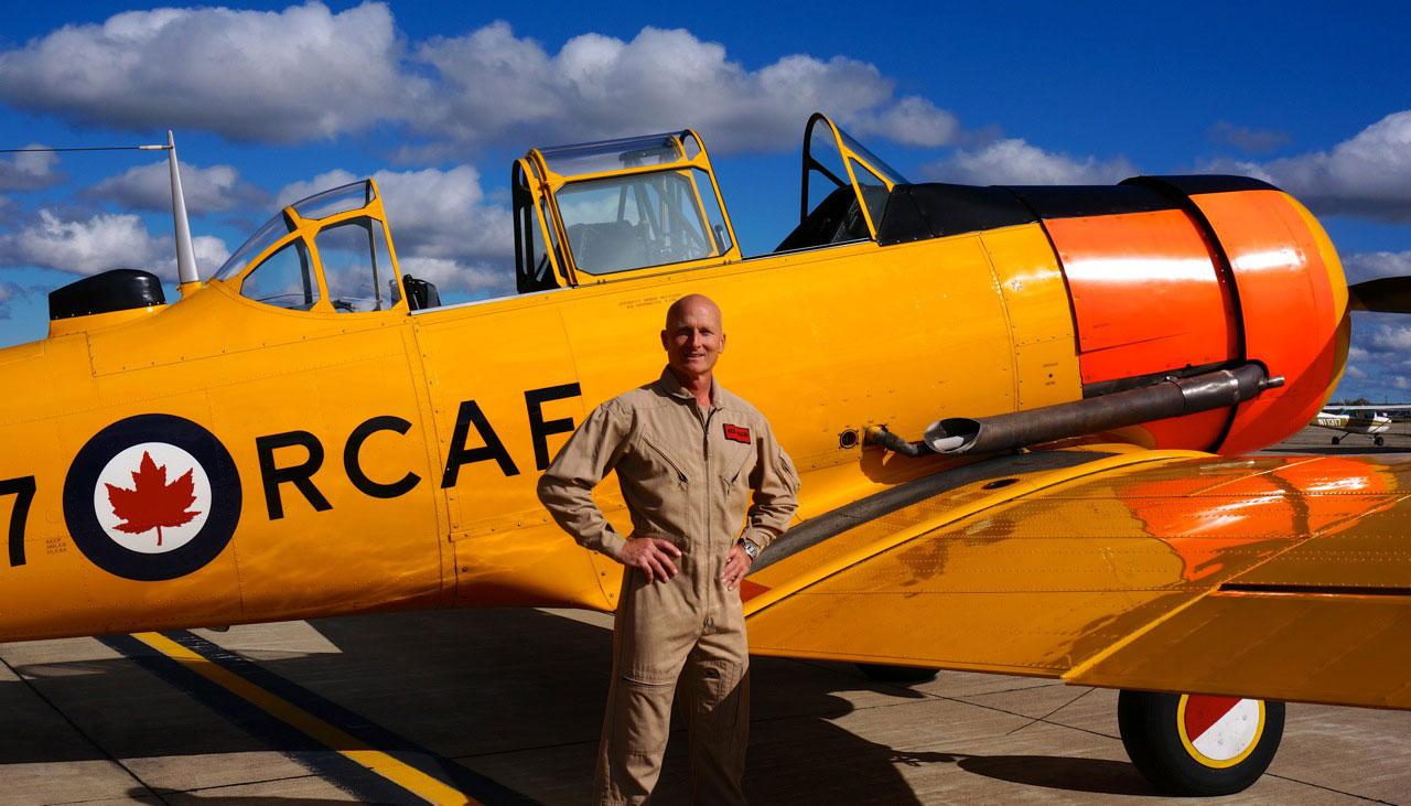 Rick Volker and his Harvard. (photo via Warbird Radio)