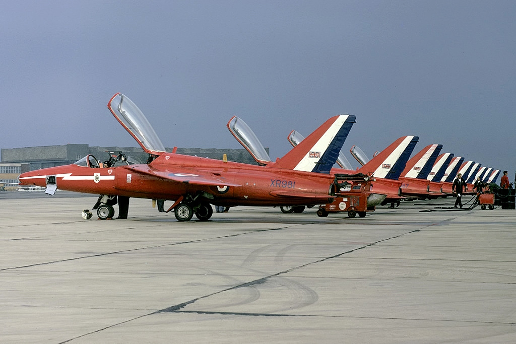 The Hawker Siddeley Gnats of the Red Arrows; seen here at RAF Kemble in 1973. (photo via Wikipedia)