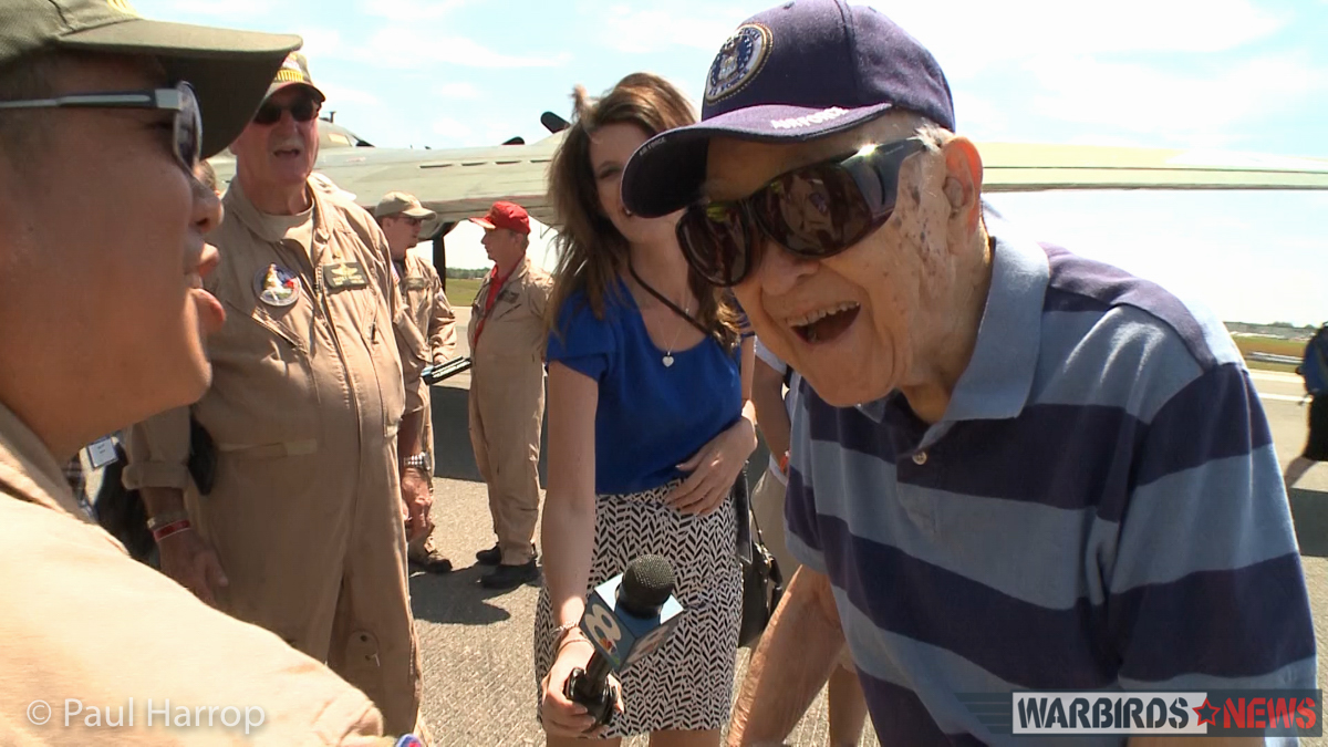 Photographer, Kevin Hong, surprises WWII veteran B-17 pilot, Col. Bill Brake at Sun 'n Fun 2016. (photo by Paul Harrop)