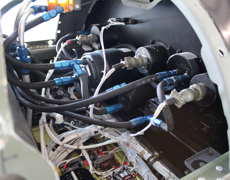 Hoses and wiring behind the co-pilot's instrument panel. (photo via Tom Reilly)