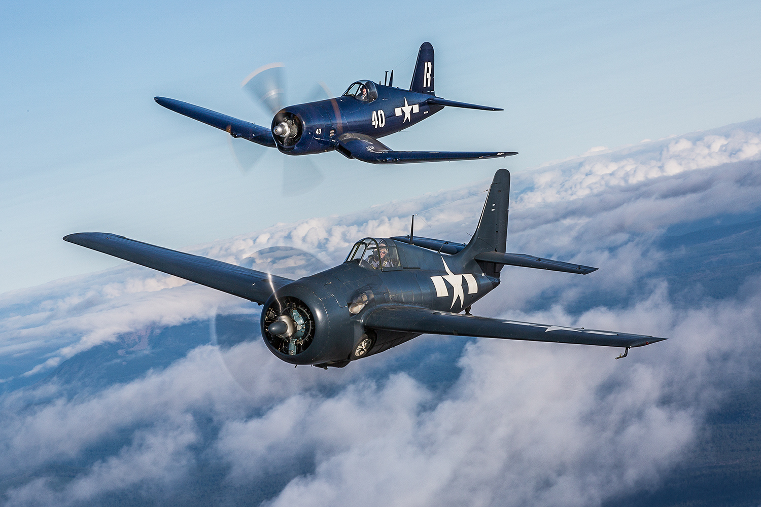 The Erickson Aircraft Collection's FM2 Wildcat and F4U-7 Corsair over the beautiful Pacific Northwest during the Air2Air Experience in 2014. (photo by Matt Booty)